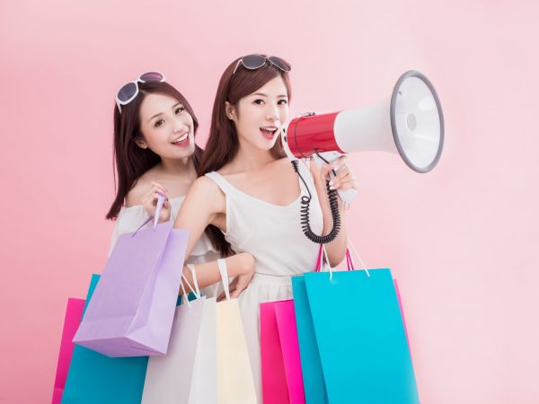 Two,Beauty,Women,Take,Microphone,And,Shopping,Begs,On,The